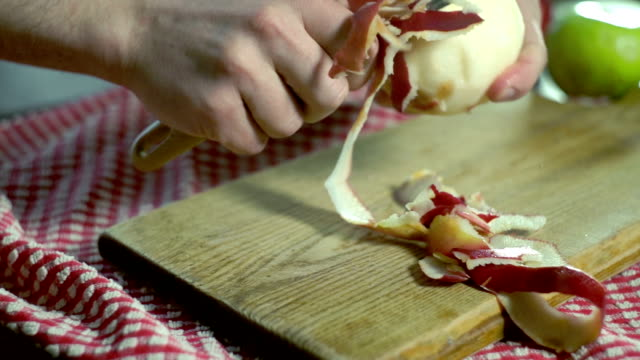 Peeled apple. Hands peeling fresh apple. Healthy food. Vegan breakfast video