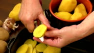 Peeled new potatoes in bowl and raw sliced potato video