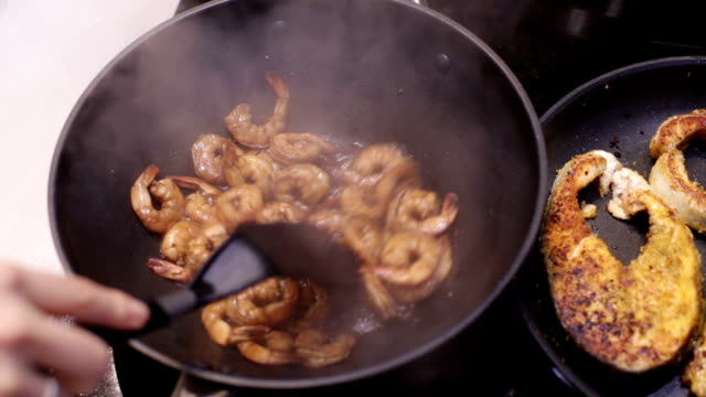 Peeled shrimp are fried in a pan video