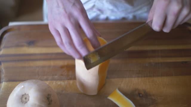 peeling butternut squash skin by knife video