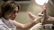 Peeling feet pedicure procedure in a beauty salon video