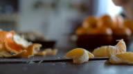 Peeling Tangerines on Wooden Table video