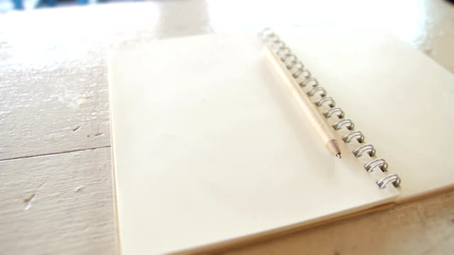 Pencil and Book with blank pages,Dolly Shot video