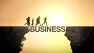 Pencil write 'Business', connecting the cliff. Businessman crossing the cliff. video