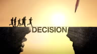 Pencil write 'DECISION', connecting the cliff. Businessman crossing the cliff. video