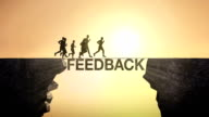 Pencil write 'Feedback', connecting the cliff. Businessman crossing the cliff. video