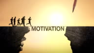 Pencil write 'MOTIVATION', connecting the cliff. Businessman crossing the cliff. video