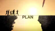 Pencil write 'PLAN', connecting the cliff. Businessman crossing the cliff. video