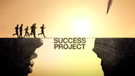 Pencil write 'Success Project', connecting the cliff. Businessman crossing the cliff. video