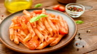 Penne with tomato sauce, basil and tomatoes video
