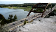 Pennybacker Bridge or 360 Bridge Austin Texas Hill country Landmark Attraction 2014 Time-lapse Cars driving and stopping from traffic and a busy Highway across the Colorado River and Skyline in the background video