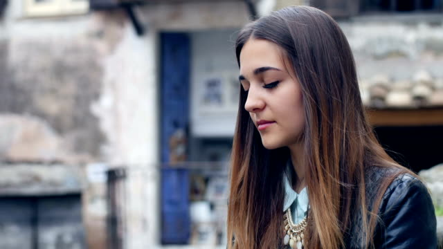 pensive and troubled young woman portrait: loneliness, sadness, thoughtful video