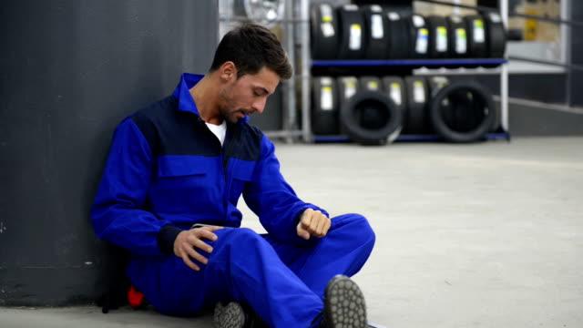 Pensive auto mechanic video