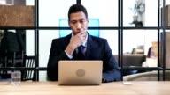 Pensive Black Businessman Working on Laptop video