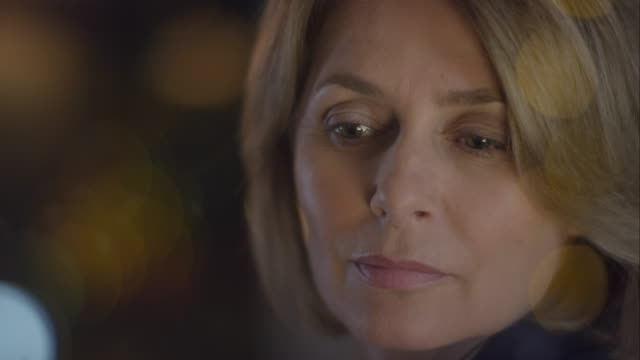 Pensive businesswoman standing in front of window video