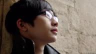 pensive chinese man is looking away video