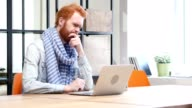 Pensive Man Working on Laptop in Office video