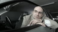 HD DOLLY: Pensive Mid Adult Man In A Car video