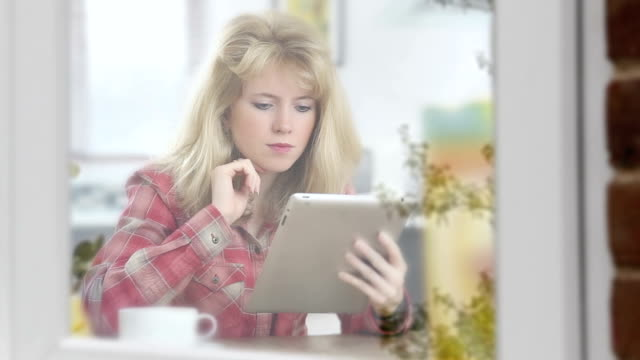 Pensive tablet girl, window reflections. video