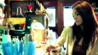 pensive woman in a pub  - dolly video