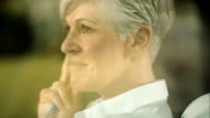 Pensive woman sitting in her living room video