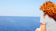 pensive woman viewing the sea from a ship: thoughtful girl in the summertime video