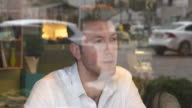 4K: Pensive young man in the coffee shop video