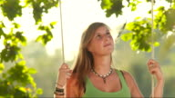 HD SLOW MOTION: Pensive Young Woman Swinging video