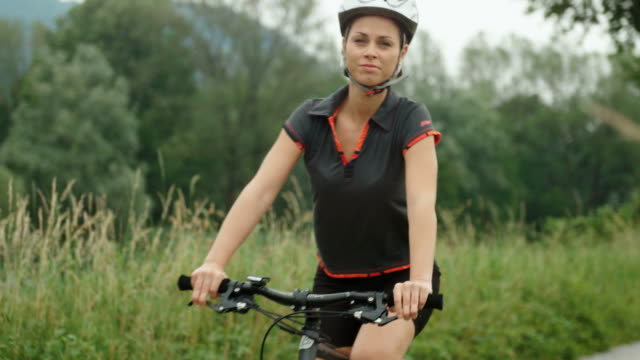 People and sport activity, young woman cycling on bicycle video