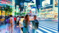 People and vehicles cross the famous Shibuya intersection in Tokyo in time-lapse video