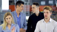 People are applauding to colleagues celebrating end of working project video