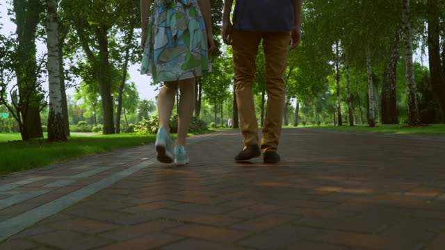 People are on track in the park. View of the feet video
