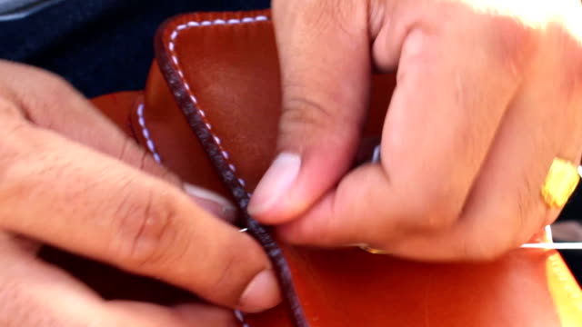 People are sewn leather wallet video