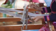 People are silk weaving in Thailand. video