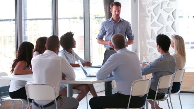 People Attending Business Meeting In Modern Open Plan Office video
