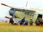 People Boarding on Biplane video