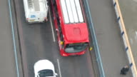 People bus and cars passing on the bridge video