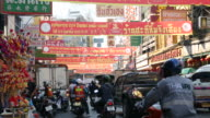 People bustling and traffic in China Town of Bangkok video