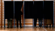 People casting votes into the ballot box video