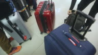 People checking their own luggages  at the airport video