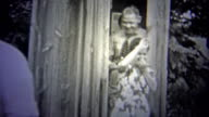 OKLAHOMA, USA - 1943: People comedically leaving a stinky outhouse. video