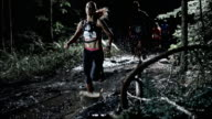 SLO MO DS People competing in trail running at night video