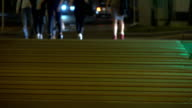 People crossing evening street. Traffic light and crosswalk. FullHD shot video