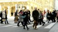 people crossing street. video