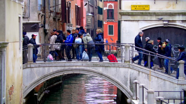 People Crossing the Bridge over the Water Canal in Venice, Italy video