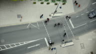 people crossing the street at a traffic light video