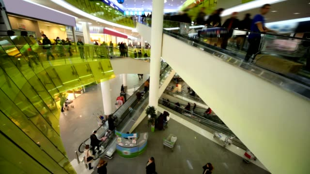 People customers moving on escalators in big mall shop video