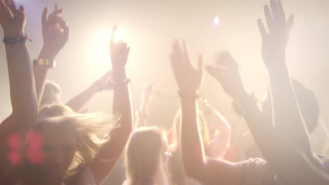People dacing in disco video