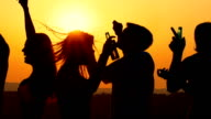 People dancing at sunset, slow motion. video