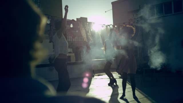 People dancing on rooftop video